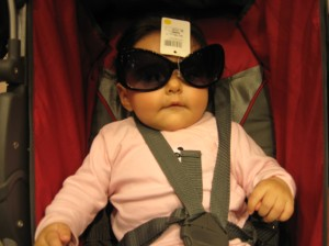 Baby trying out new sunglasses