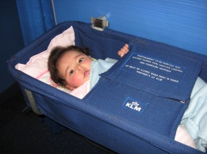 Baby in crib on airplane