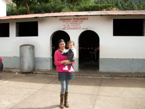 Patricia with the baby outside Señor de Huanca