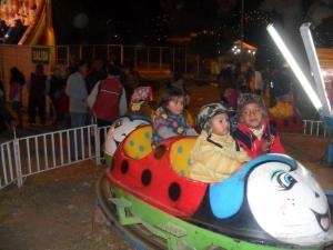 Brianna riding the fair outside of the Colliseo Cerrado in Cuzco