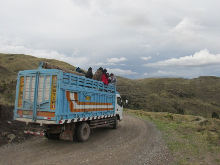 kids riding in bed of truck in Peru to go to school